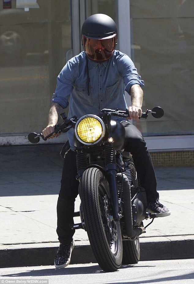 David Beckham smoulders in a muscle vest on a ride around ...