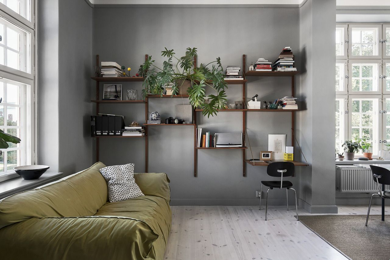 Grey living room with small workspace