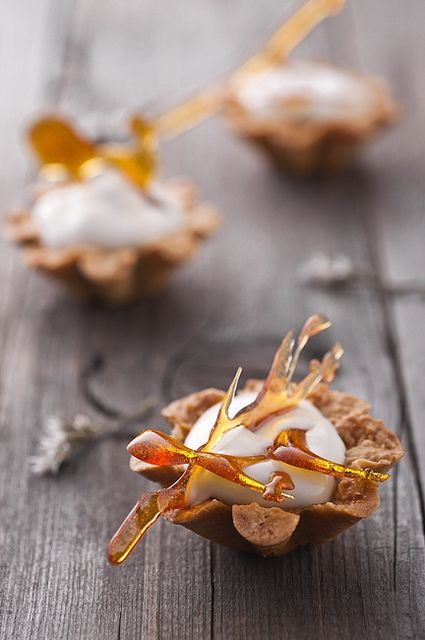 Photo of Maple mousse in almond basket with caramel decoration