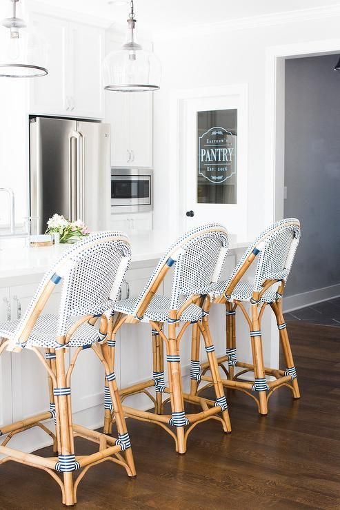 Serena Lily Riviera Counter Stools Sit On A Dark Stained Oak Floor In Front Of An All White Kitc Kitchen Interior Design Modern Modern Kitchen Interiors Home
