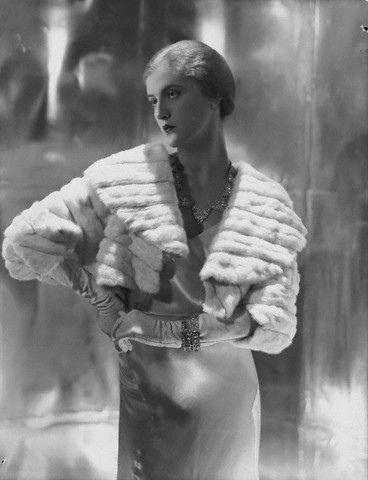 model wearing short ermine summer jacket. fashion photo by George Hoyningen-Huene (1931)
