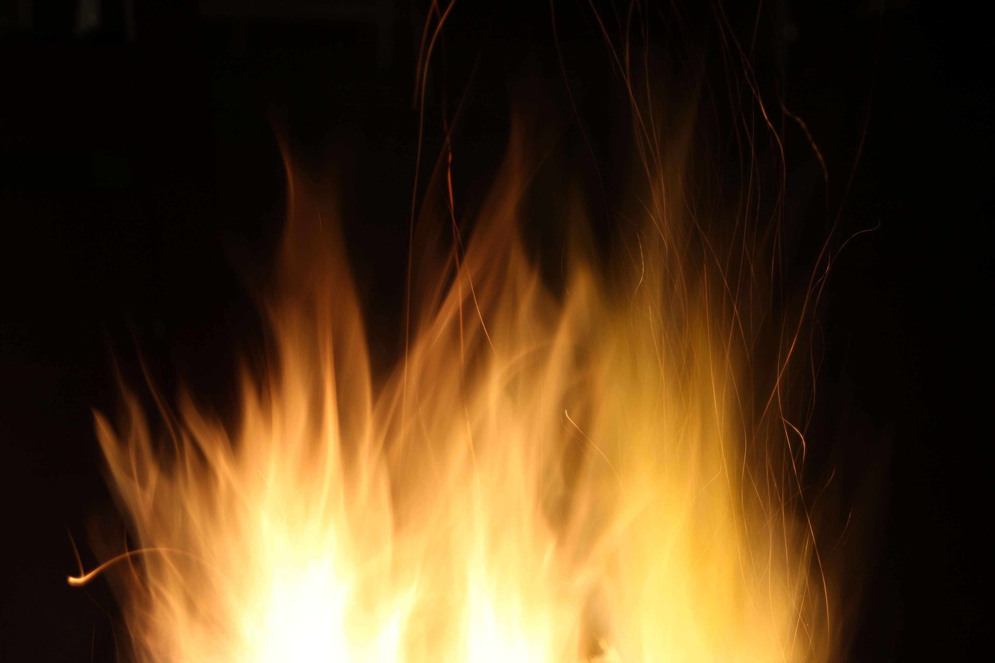 closeup dark fire fire pit flame flames heat night yellow