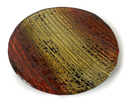Golden tones melting into fiery orange remind one of a glorious sunset when the sky turns into magnificent colours. Our master craftsman have captured this in fused glass for you to treasure in your home! Each piece is hand made by adding pigments to the glass and then firing in a kiln. A unique ornament is created! This bowl, sized at 30cm diameter round, will delight the eye with its bright eye-catching design.