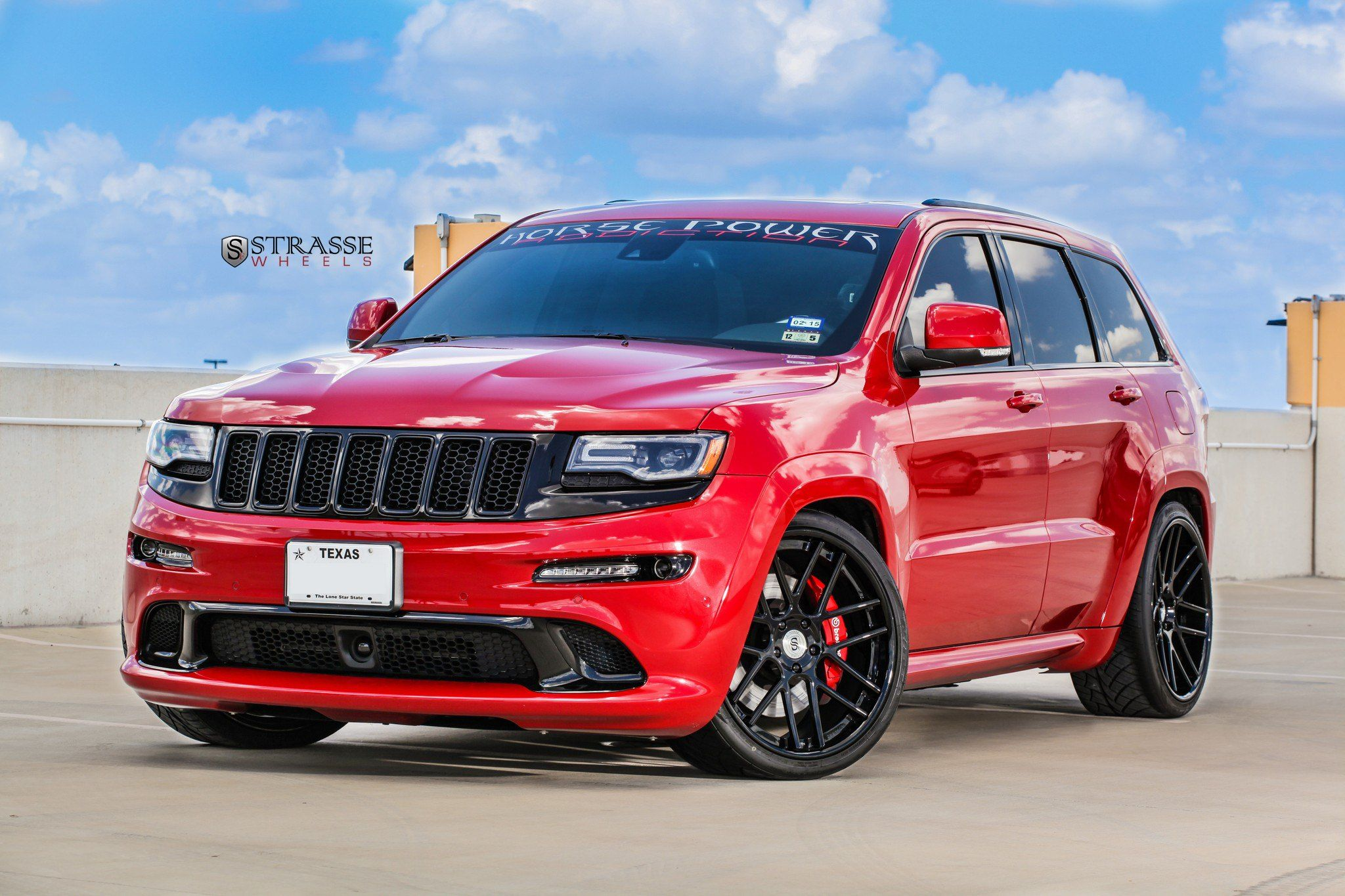 Red Jeep Grand Cherokee On Gloss Black Strasse Wheels Featuring Red Calipers Jeep Grand Cherokee Srt Jeep Grand Red Jeep
