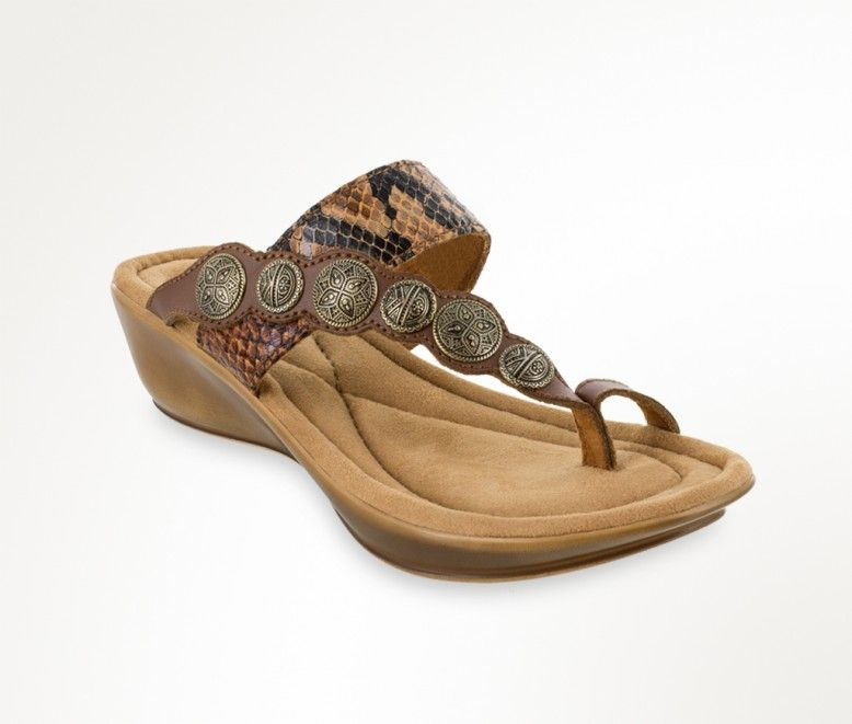682b13fd4a58 Embrace Southwest style in this sturdy leather sandal detailed with tooled  metal hardware and fierce python accents.