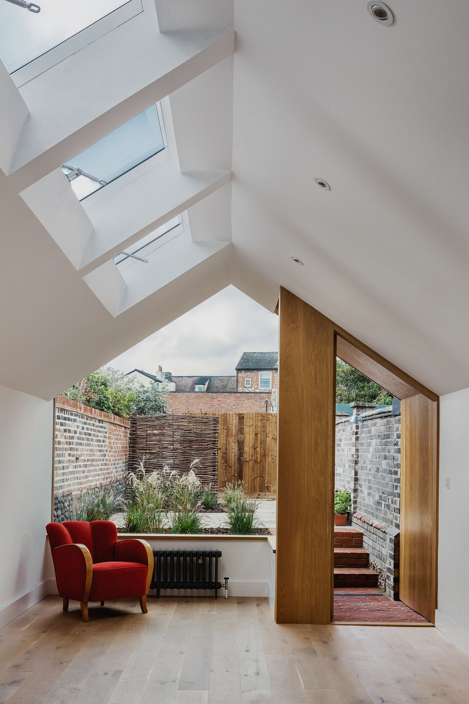Small rear garden along with the kitchen and dining of the contemporary extension
