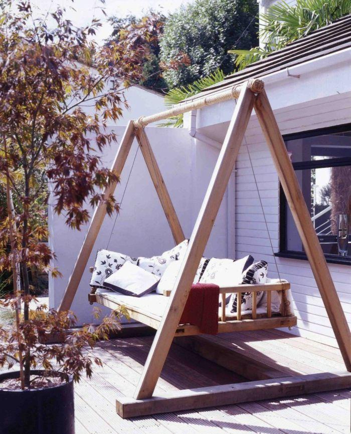 Garden swing changes the garden look in a great way