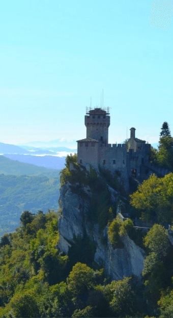 Want to see San Marino a tiny micro nation in Italy? It's the 5th smallest nation in Europe landlocked, but also incredibly picturesque to visit. You'll find yourself in walled cities atop high mountains wandering in Dogana and the city of San Marino. Learn how to reach San Marino from Rimini Italy and why you must put this nation on your travel bucketlist. Feel the history of San Marino which has been a republic since it's foundation and experience the Tower Cesta straight out of a Disney…