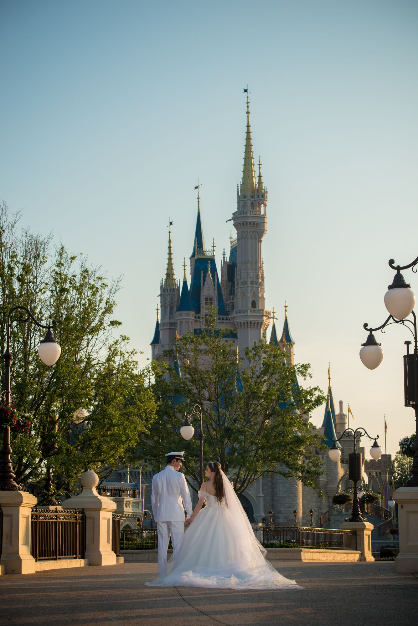 walking hand in hand through the magic kingdom toward cinderella