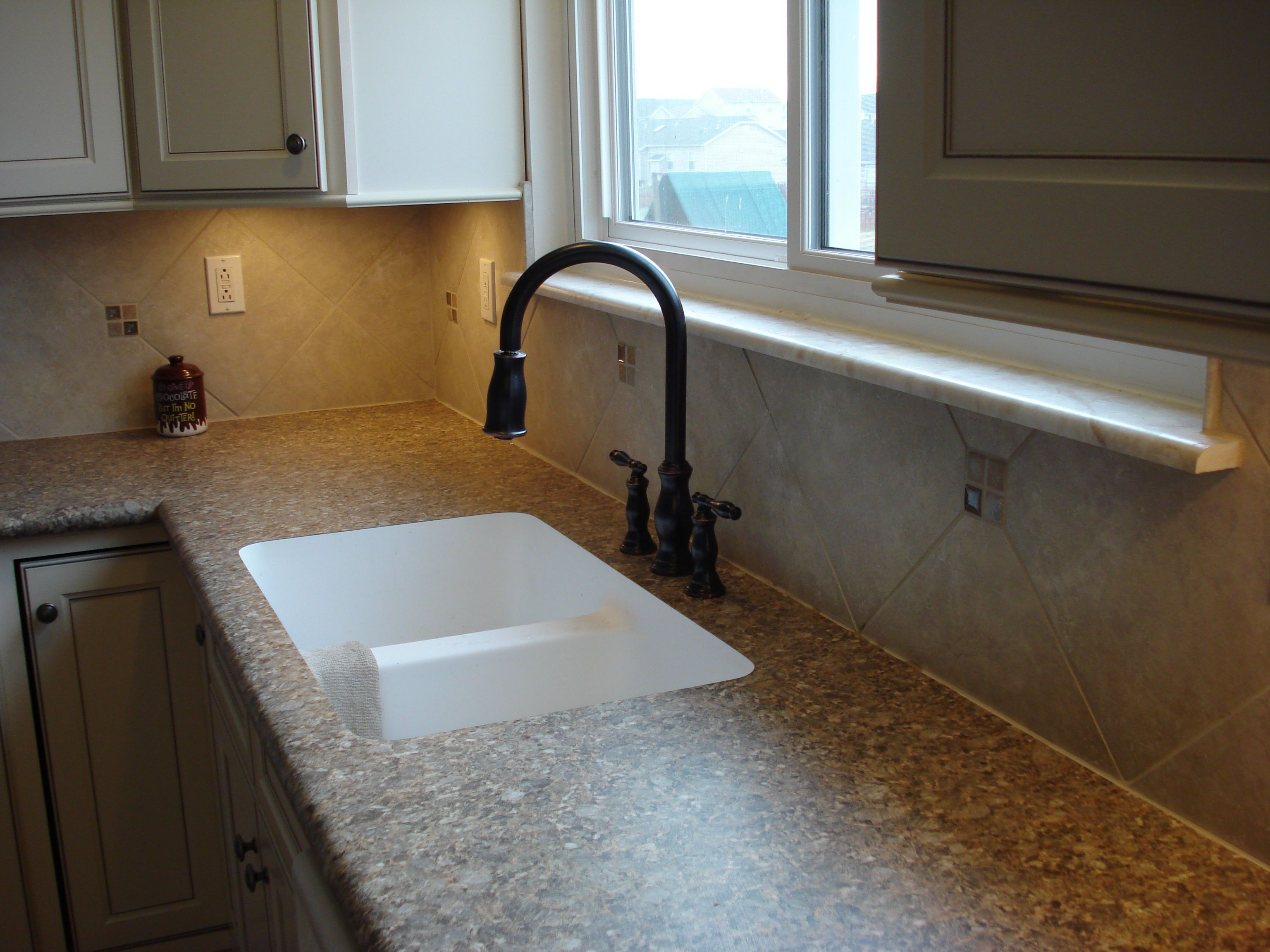 12 X 12 Tile Backsplash With Inserts Edge Sink Installed In A Laminate Countertop Backsplash Countertops Sink Countertop