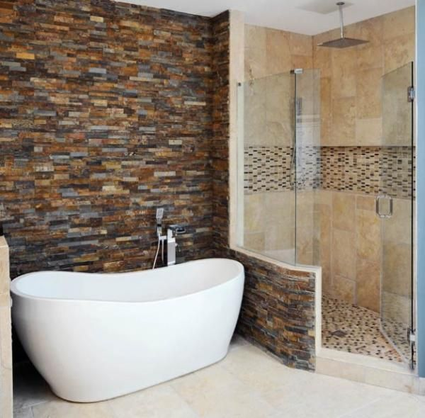 dream bathroom. brick wall and deep stand alone tub. relaxation and