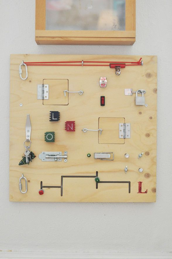 Activity board can include pulleys, switches, doors that open to reveal a mirror or a chalkboard.  So much room for creativity here!