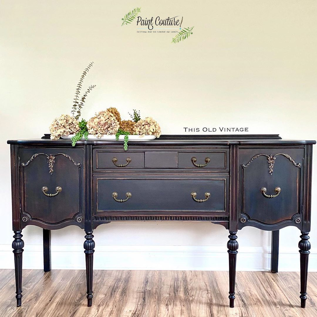 Simply gorgeous buffet by This Old Vintage painted in Baltic Black with a distressed finished. Who is in LOVE with this look? 🤩🖤 #balticblack #paintcouture #paintcouturepaint #couturecreators #thisoldvintage #vintagefurniture #paintedfurniture #refurbishedfurniture