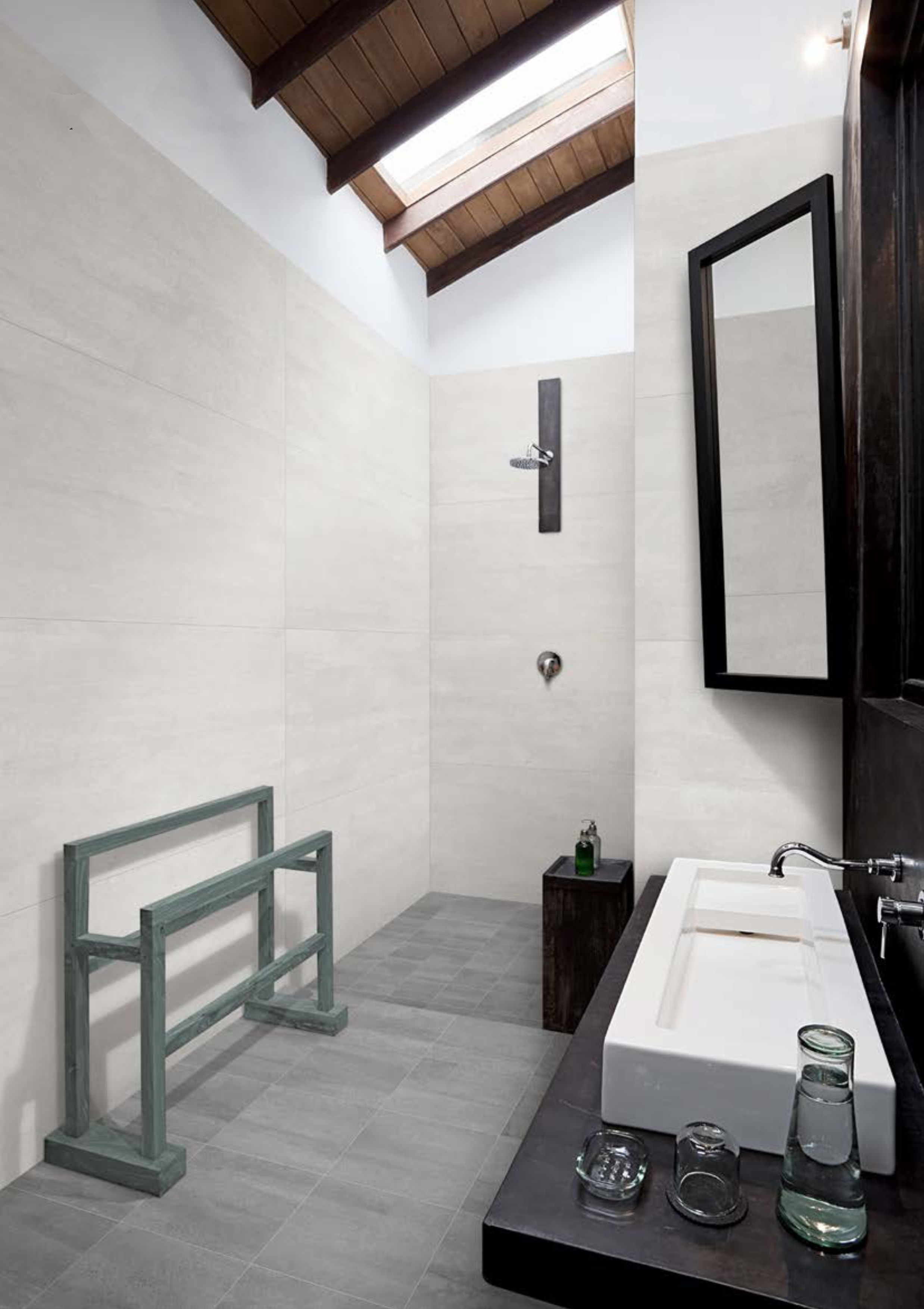 This modern bathroom has a stone look tile called Beton Axis white ...
