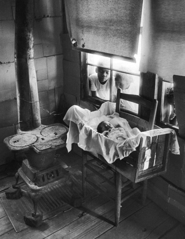 William Eugene Smith, Newborn Baby in Makeshift Crib near Cold Stove, 1951.