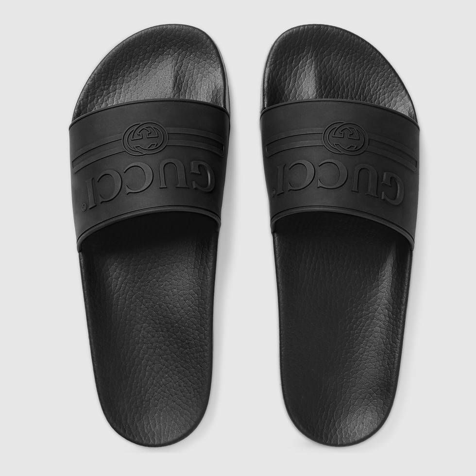 ad865ca167b Shop the Gucci logo rubber slide sandal by Gucci. The feel of summer  permeates the