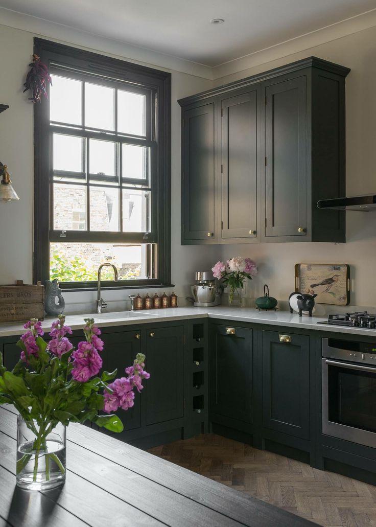 dark gray kitchen cabinets with brass hardware off
