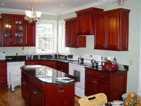 cherry cabinets and rounded oval shaped island