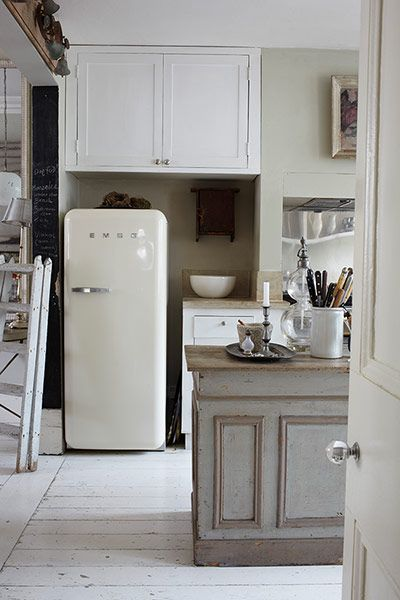 Credit: Holly Jolliffe/Guardian Layers of matt paint and some judicious sanding-off is what gives this kitchen its antiqued feel and it's a style which can be reproduced relatively cheaply with a few tins of Farrow & Ball flat emulsion. For a Smeg fridge like this one, go to Homebase. If all that painting seems too much, freestanding furniture can be found at