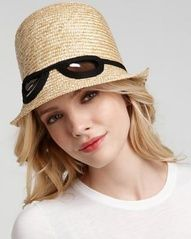 Love this whimsical straw hat with cat-eye sunglasses. From 25 Accessories to Beat a Bad Hair Day
