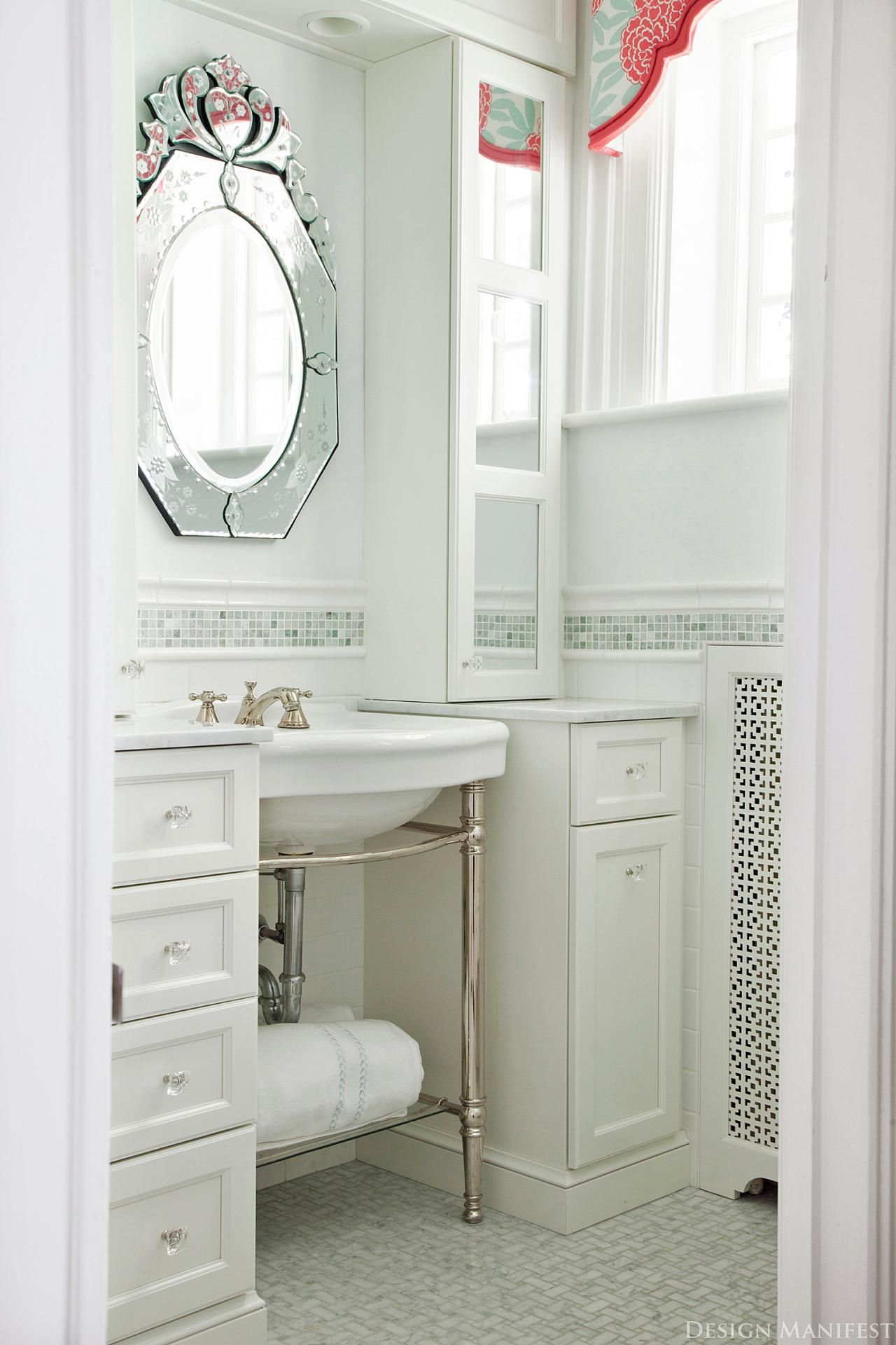 This tiny bathroom makes smart use of every inch. An open shelf ...