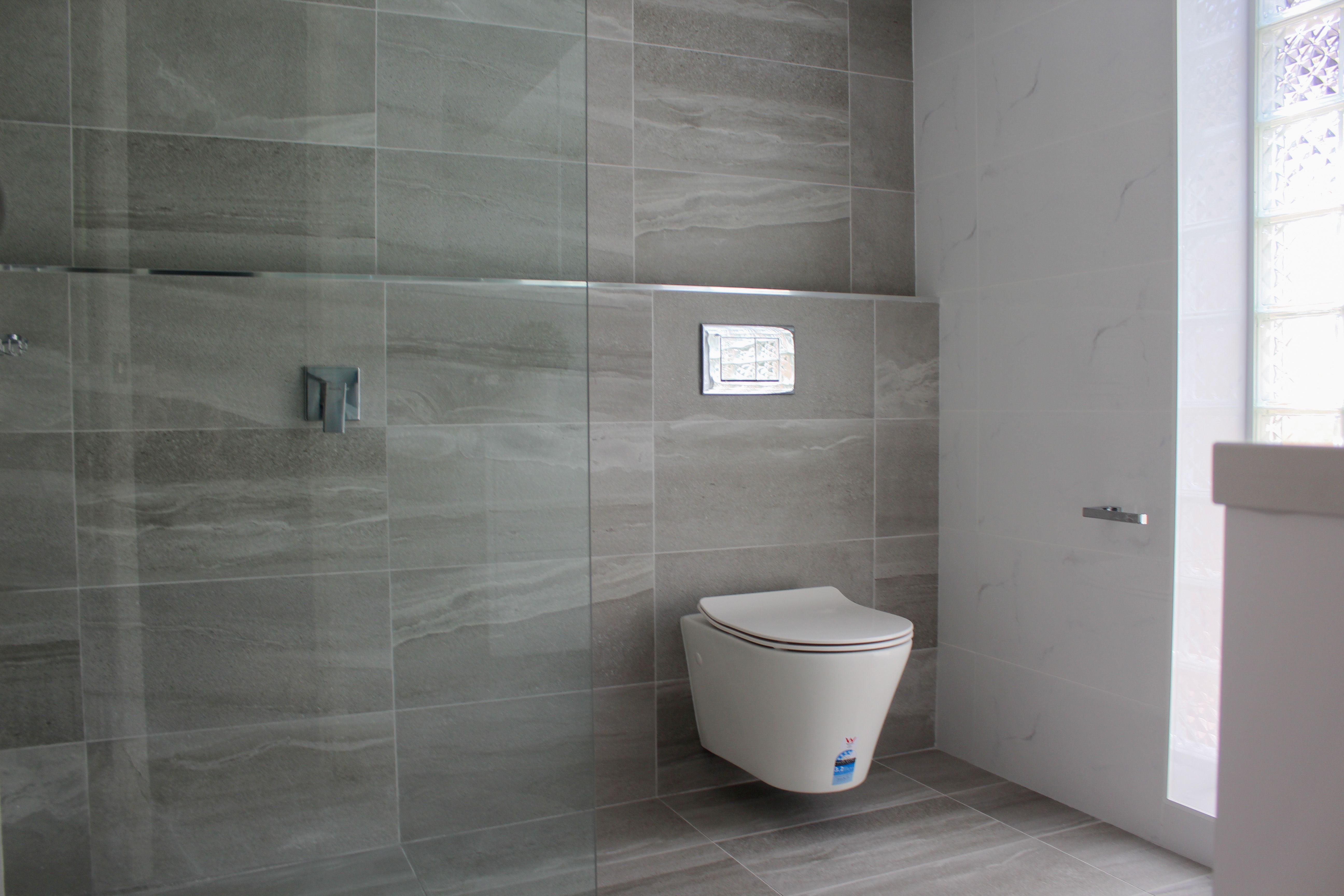 Small Ensuite Renovation Ensuite Renovation Grey Feature Wall Walk In Shower Bathroom Renovations Beautiful Bathroom Renovations Small Bathroom Renovations