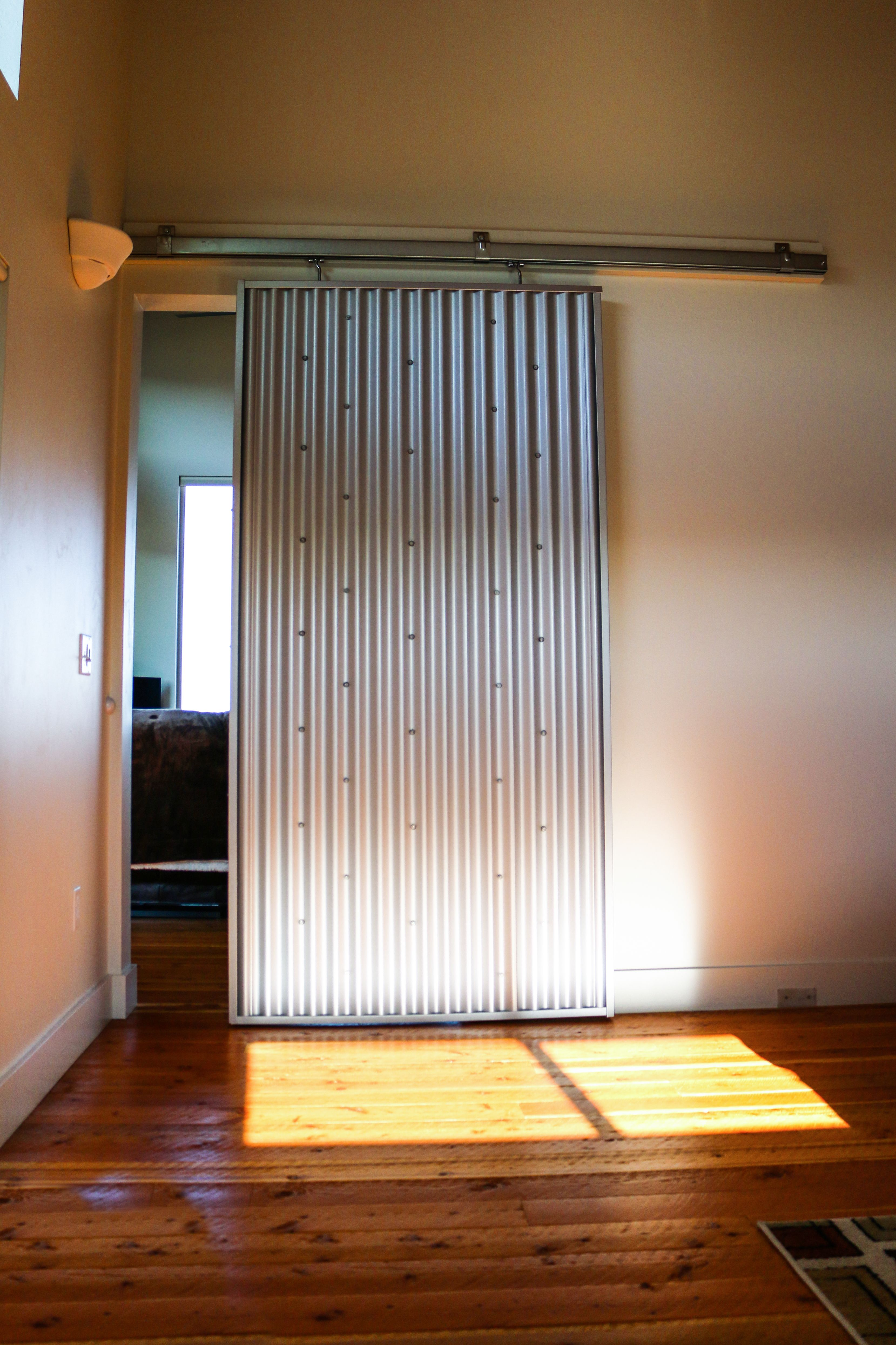 Check Out This Interior Sliding Door Made From Corrugated Metal In Galvalume Sliding Doors Interior Metal Building Homes Barn Doors Sliding
