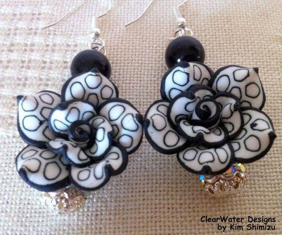 Polymer Clay Jewelry Flower Dangle Earrings by ClearWaterDesignsbyK on Etsy, $24.96  These long Flower Dangle Earrings are handmade with Polymer Clay & hand painted black & white. The pretty Silver Rhinestone Beads catch the light as you move for some added sparkle! These Earrings are made with Hospital Grade Surgical Steel.
