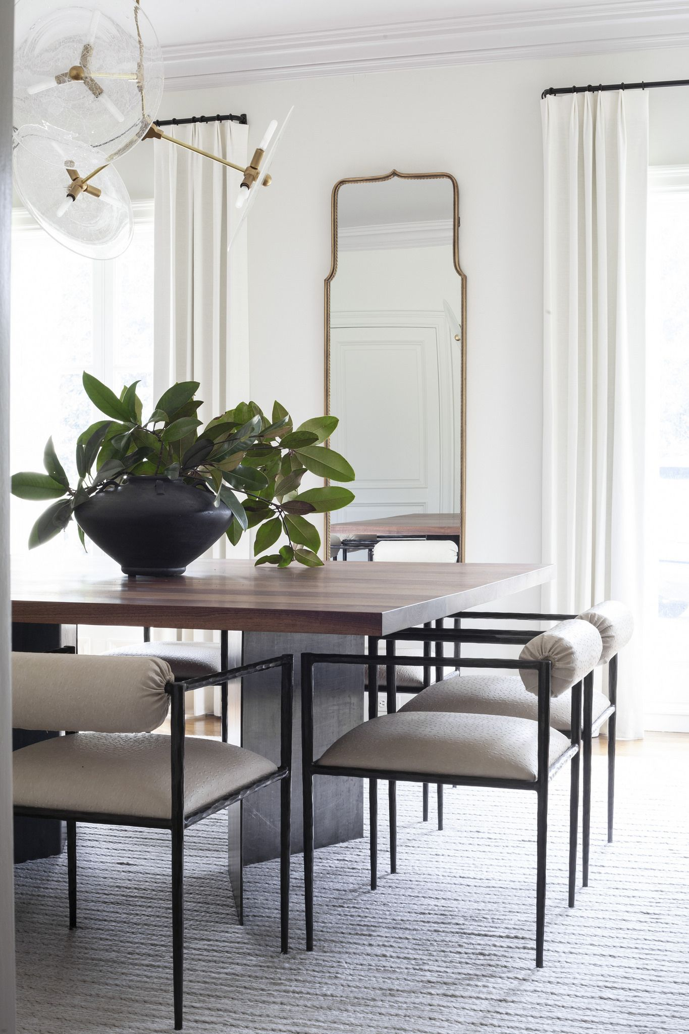 Tall Arched Mirror In The Dining Room White Walls White