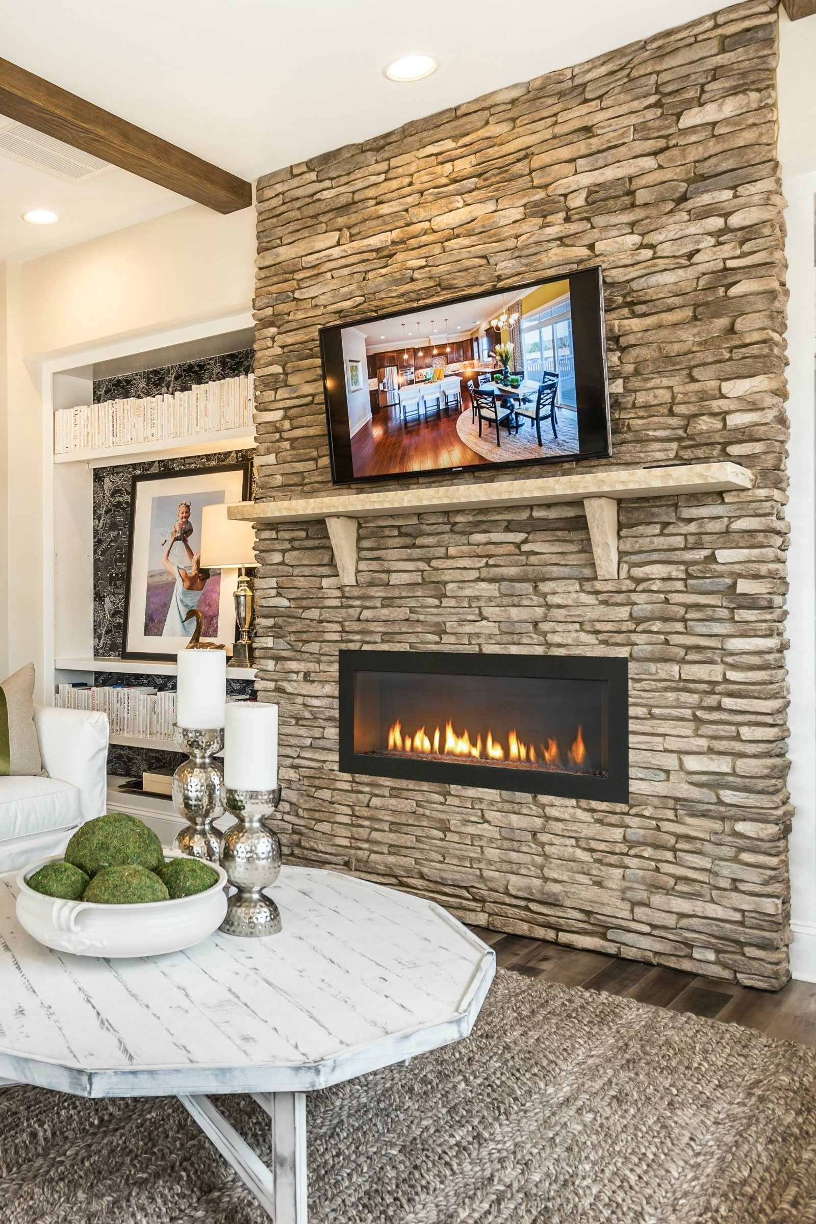 A Stacked Stone Wall Accented By Heat Glos Cosmo Gas Fireplace Anchors This Modern Farmhouse Living Room Designed