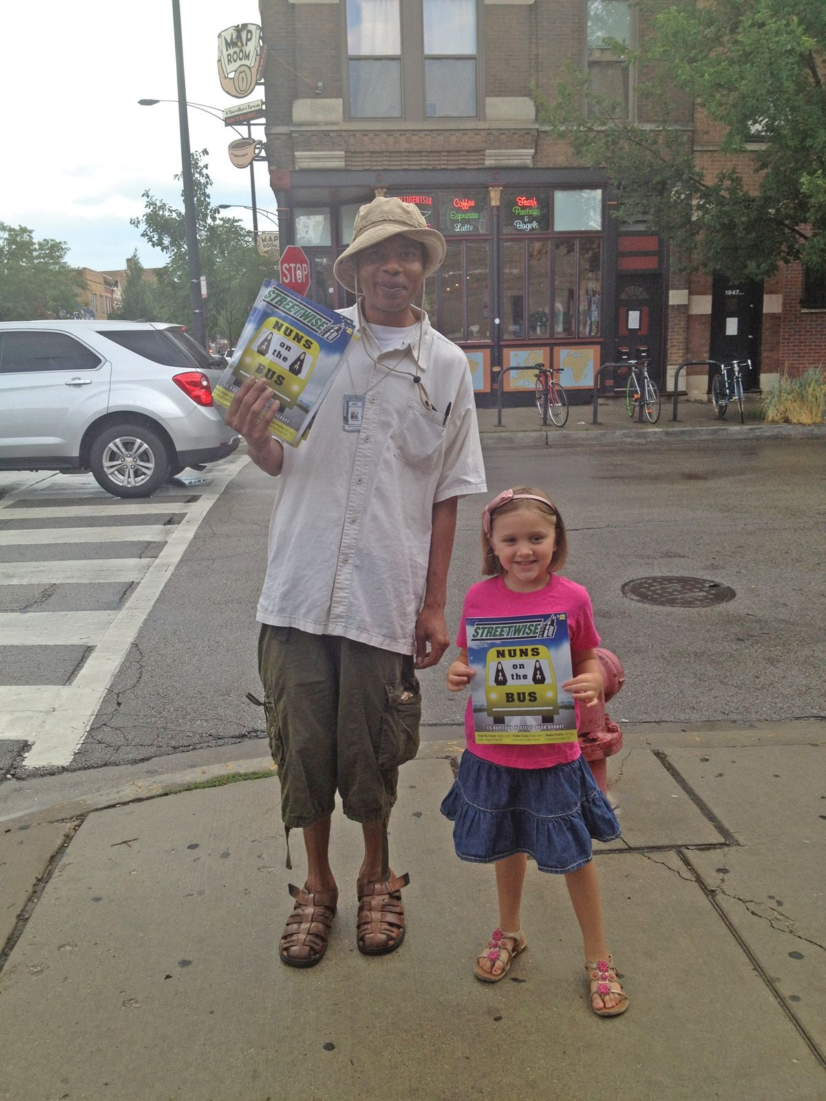 """Theresa Breakiron sent this photo in and wrote, """"No matter what, [my daughter, Bella, and I] both always enjoy the smile on our other favorite StreetWise Vendor and QAT Member Ahmand Mayfield. He is a joy to see and continues to teach my daughter the meaning of hard work, dedication and to be most thankful for the little things in life, like friendship. Thanks, StreetWise."""""""