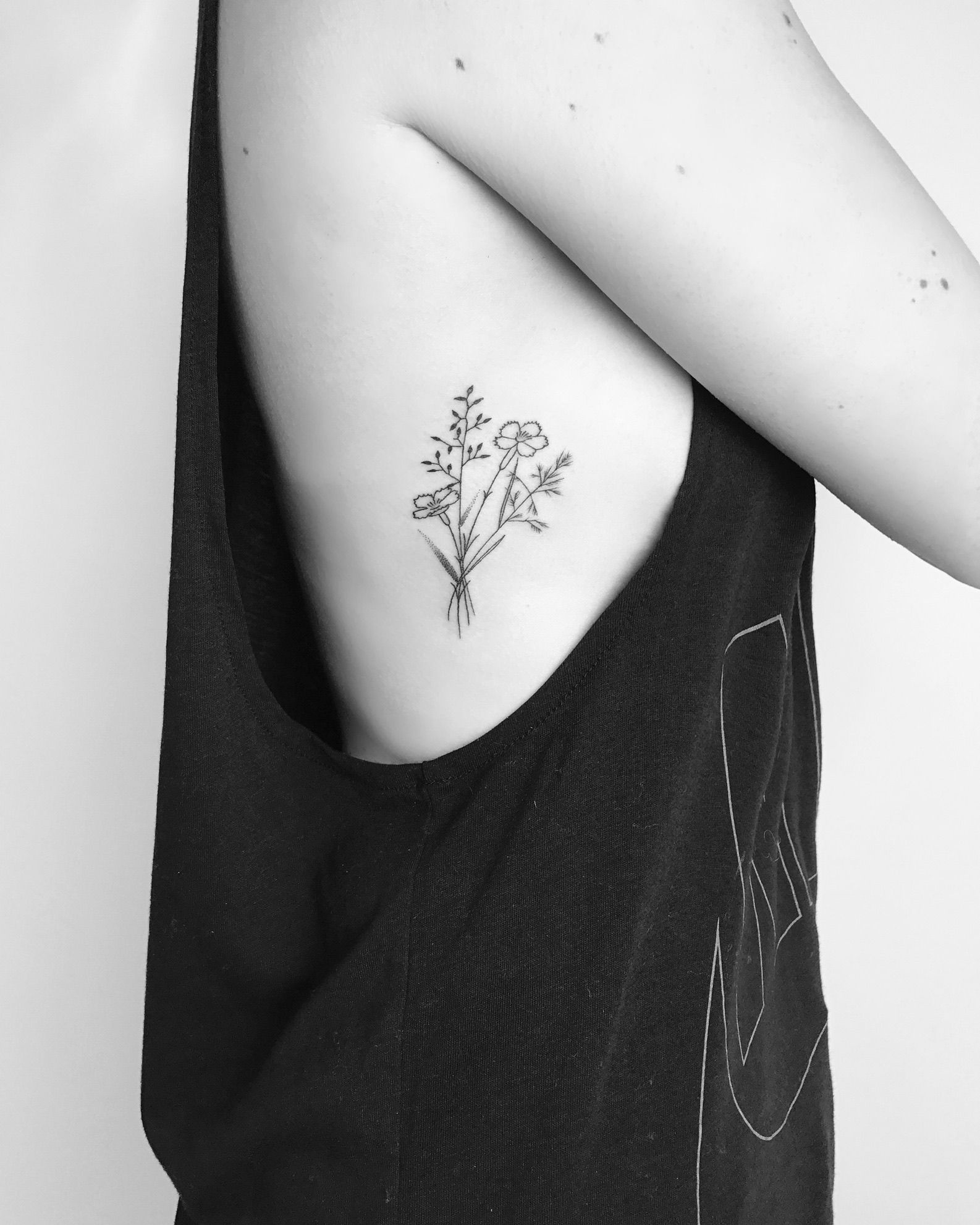 Small Minimalist Wildflower Tattoo With Fine Black Lines And