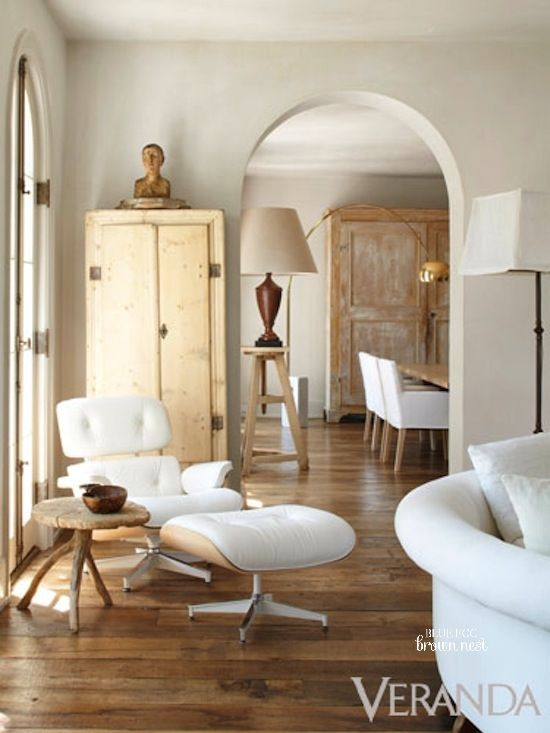 Beige interior, white Eames chair, wood floor. Elegant neutrals.