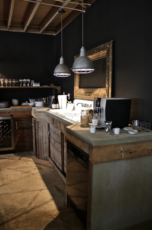 Rustic industrial kitchen with black walls concrete for Rustic industrial kitchen lighting