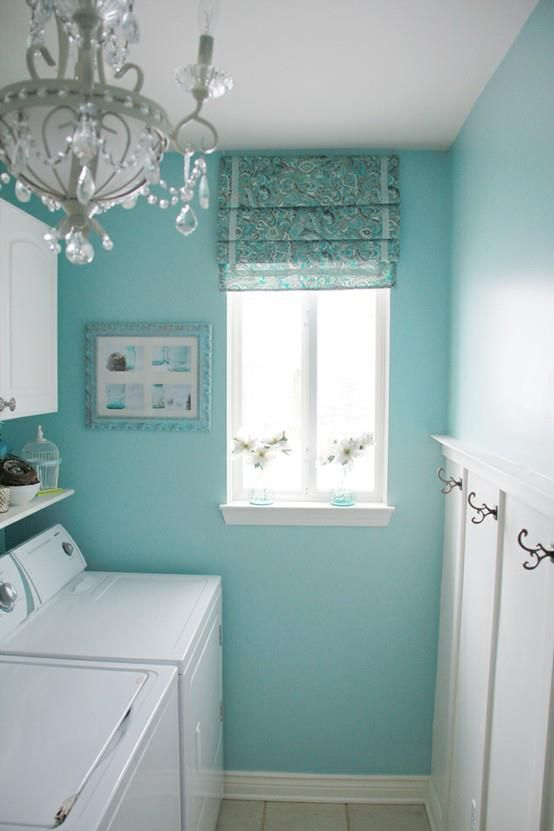 Blue laundry room, white beadboard with hooks... and a chandy!