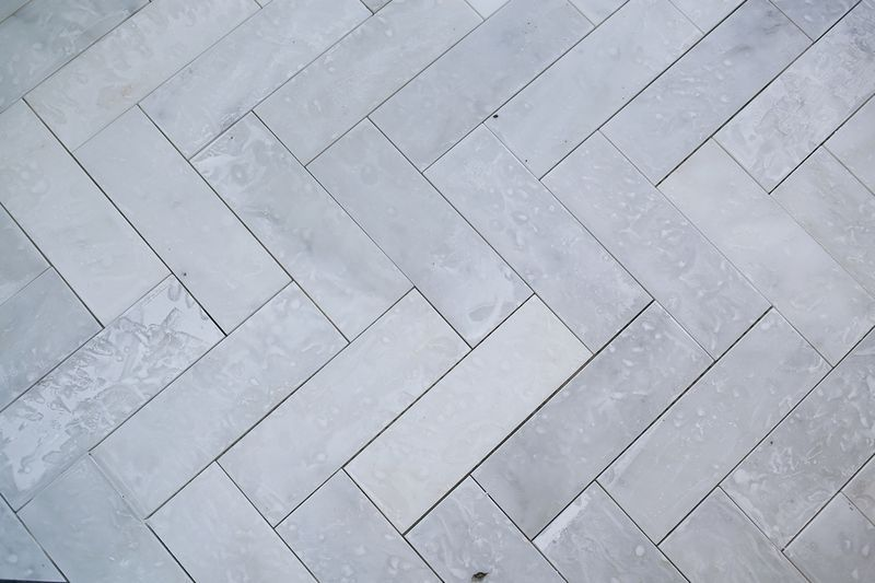 Try This Herringbone Marble Tile A Beautiful Mess Marble Tiles Herringbone Tile Floors