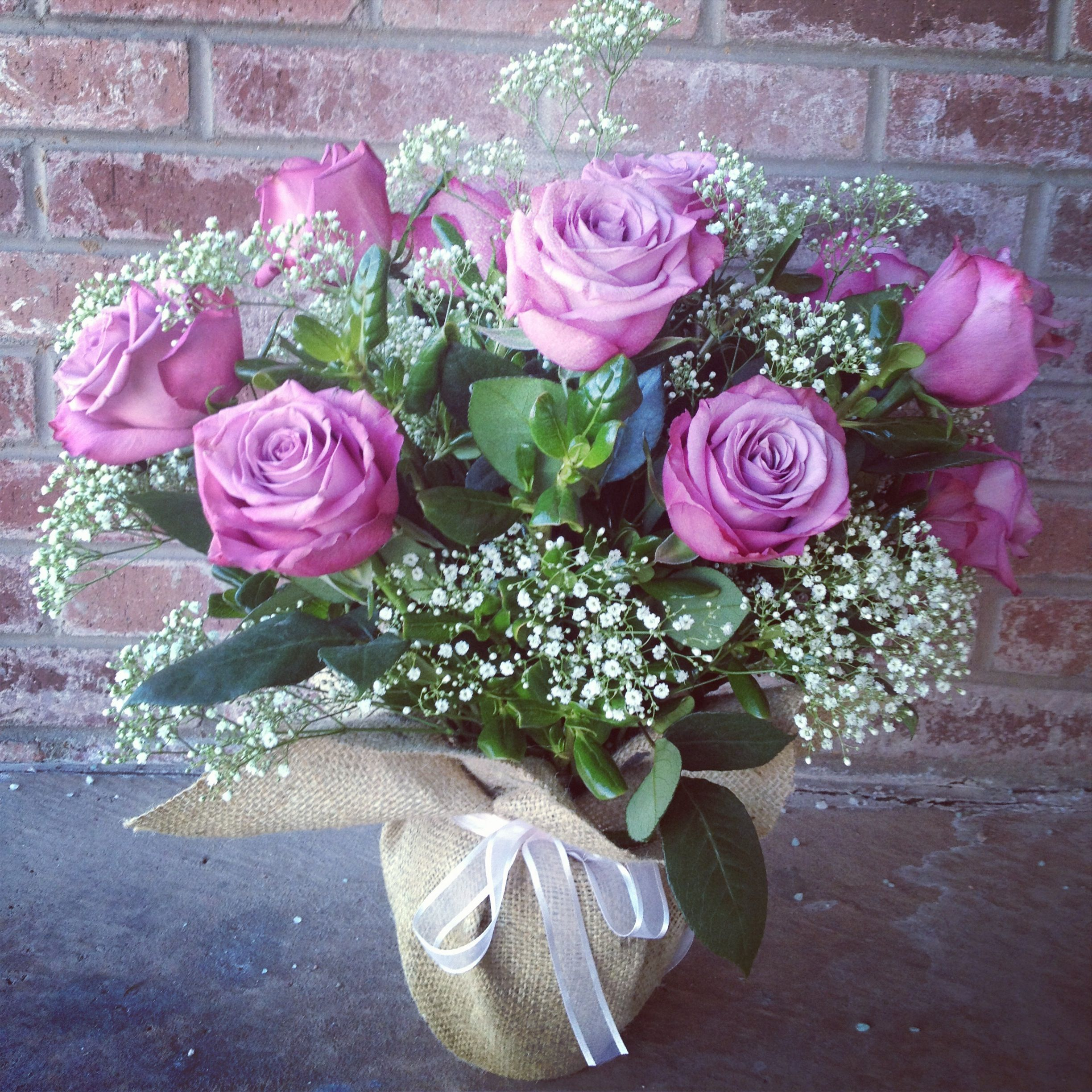 Lavender roses, baby's breath wrapped in burlap