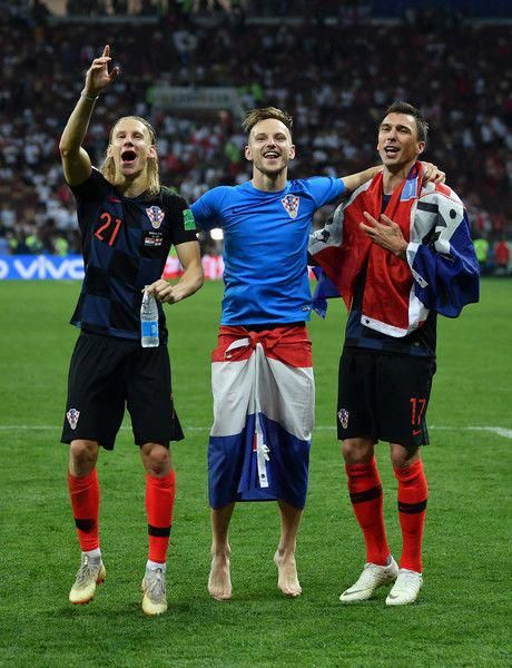 Domagoj Vida of Croatia, Ivan Rakitic of Croatia and Mario Mandzukic of Croatia celebrate victory together after the 2018 FIFA World Cup Russia Semi Final match between England and Croatia at Luzhniki Stadium on July 11, 2018 in Moscow, Russia. #soccer