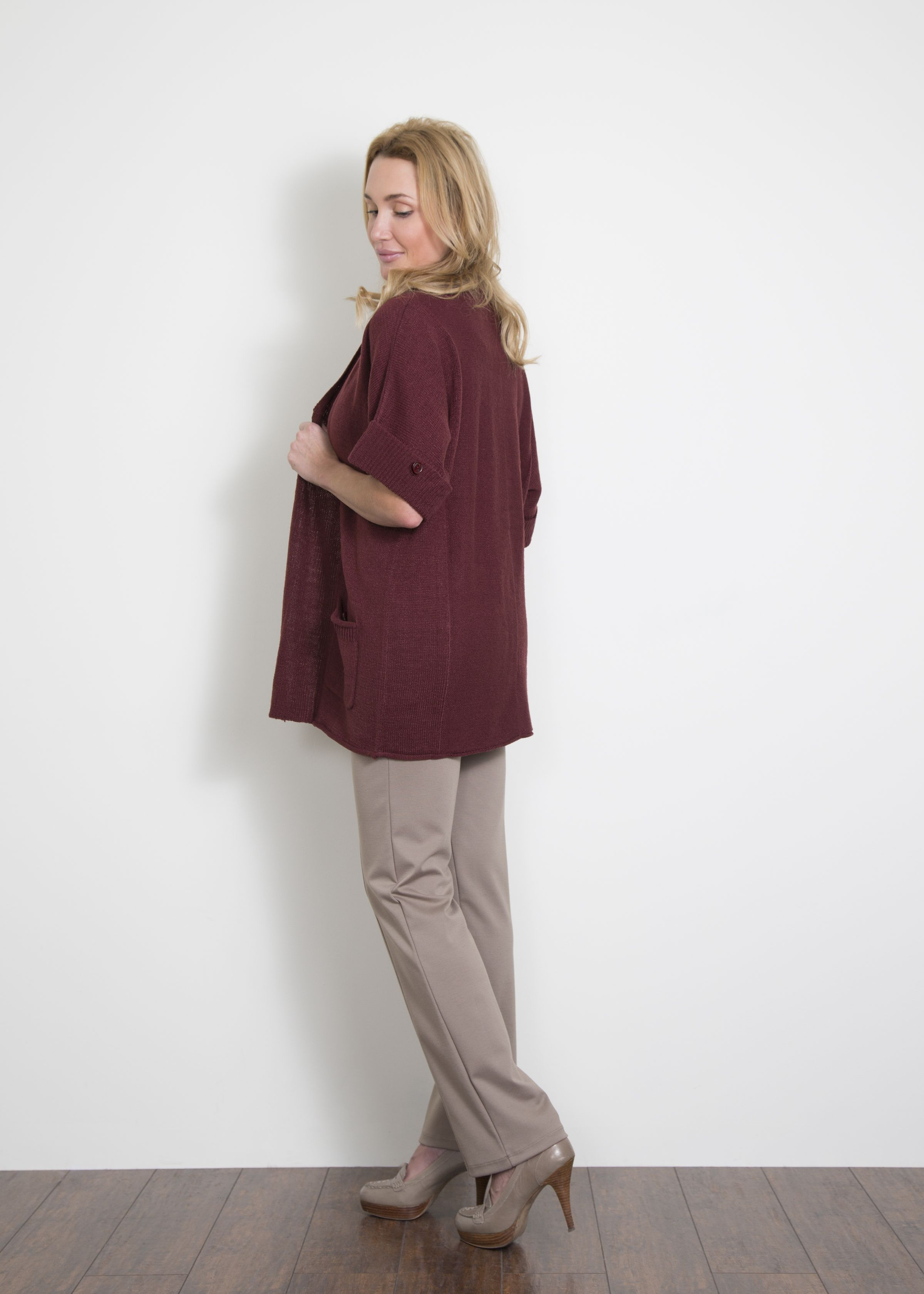 Be chic at work with this short sleeve cardigan with pockets ...