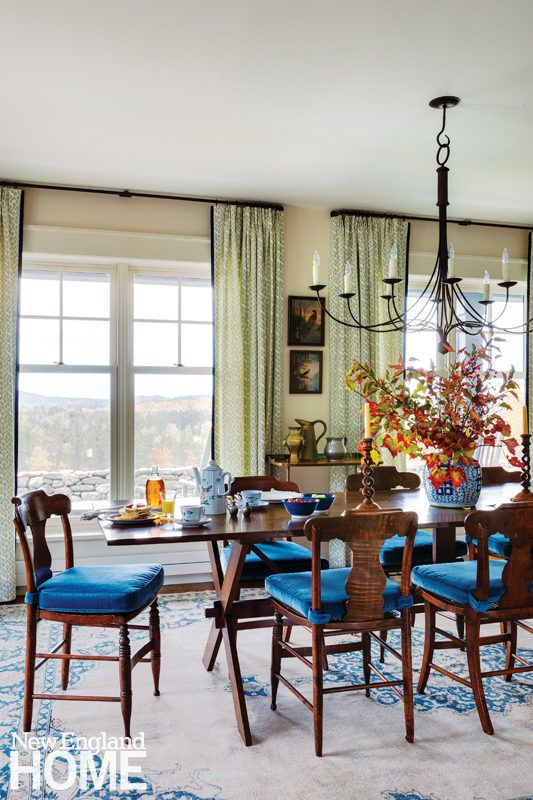 The dining room was furnished around the eleven foot long nineteenth   century convent table found in a shop in Pennsylvania  The Oushak rug is an  antique. This cozy dining room was furnished around the eleven foot long