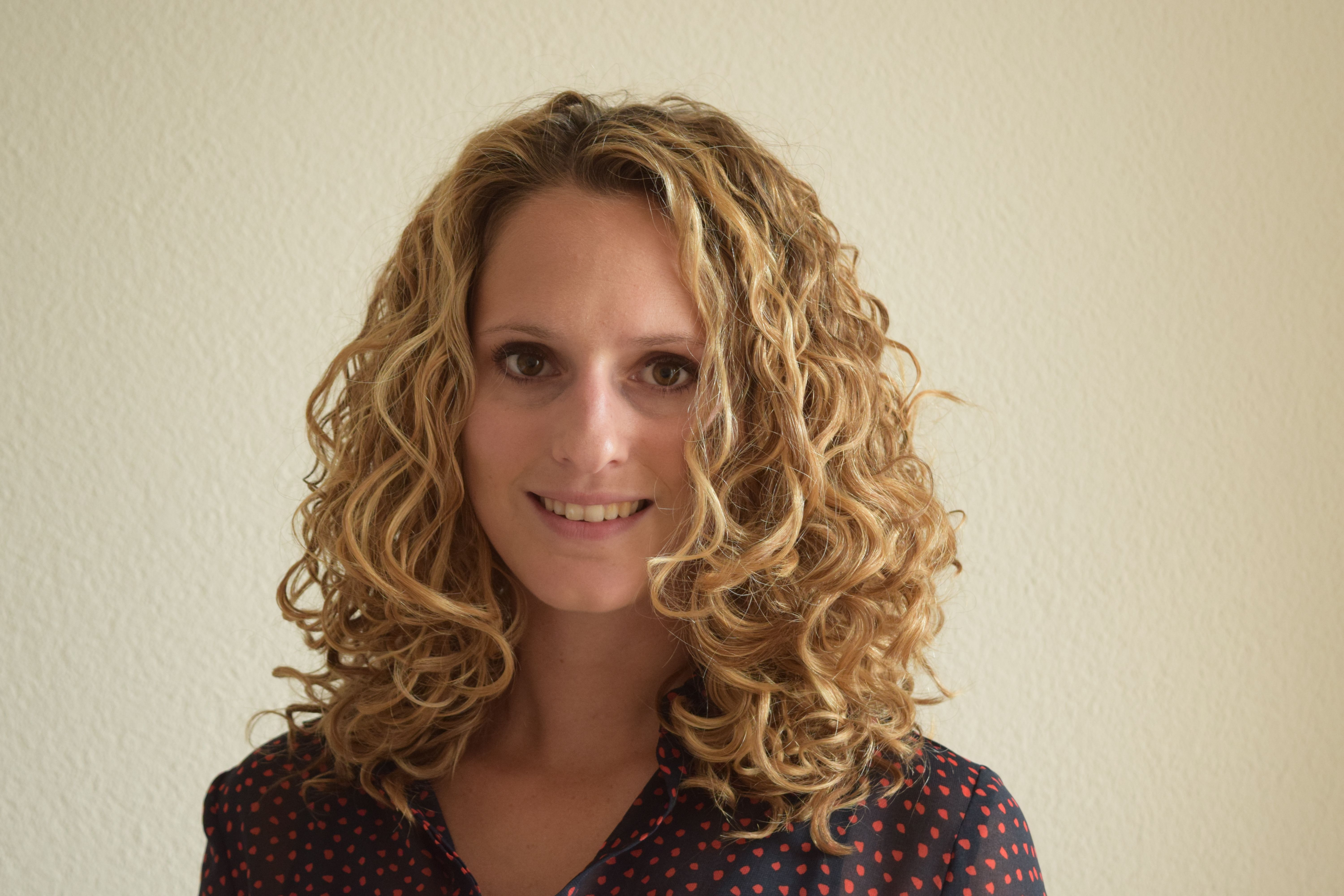 Get more root volume – clipping curly hair with bobby pins