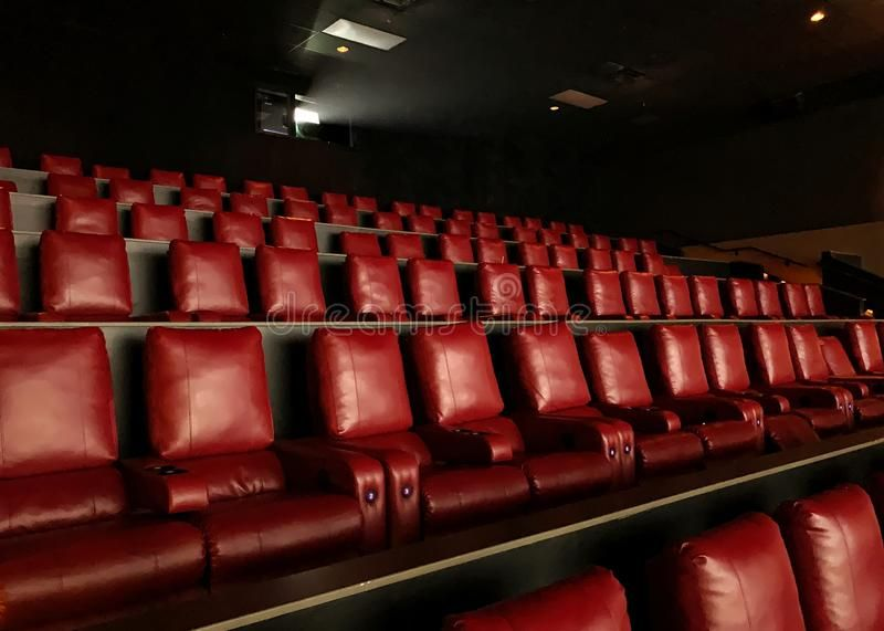 Rows Of Modern Reclining Seats In A Movie Theater Empty Red Seats In A Movie Th Affiliate Seats Movie Reclining Rows Movie Theater Seating Modern