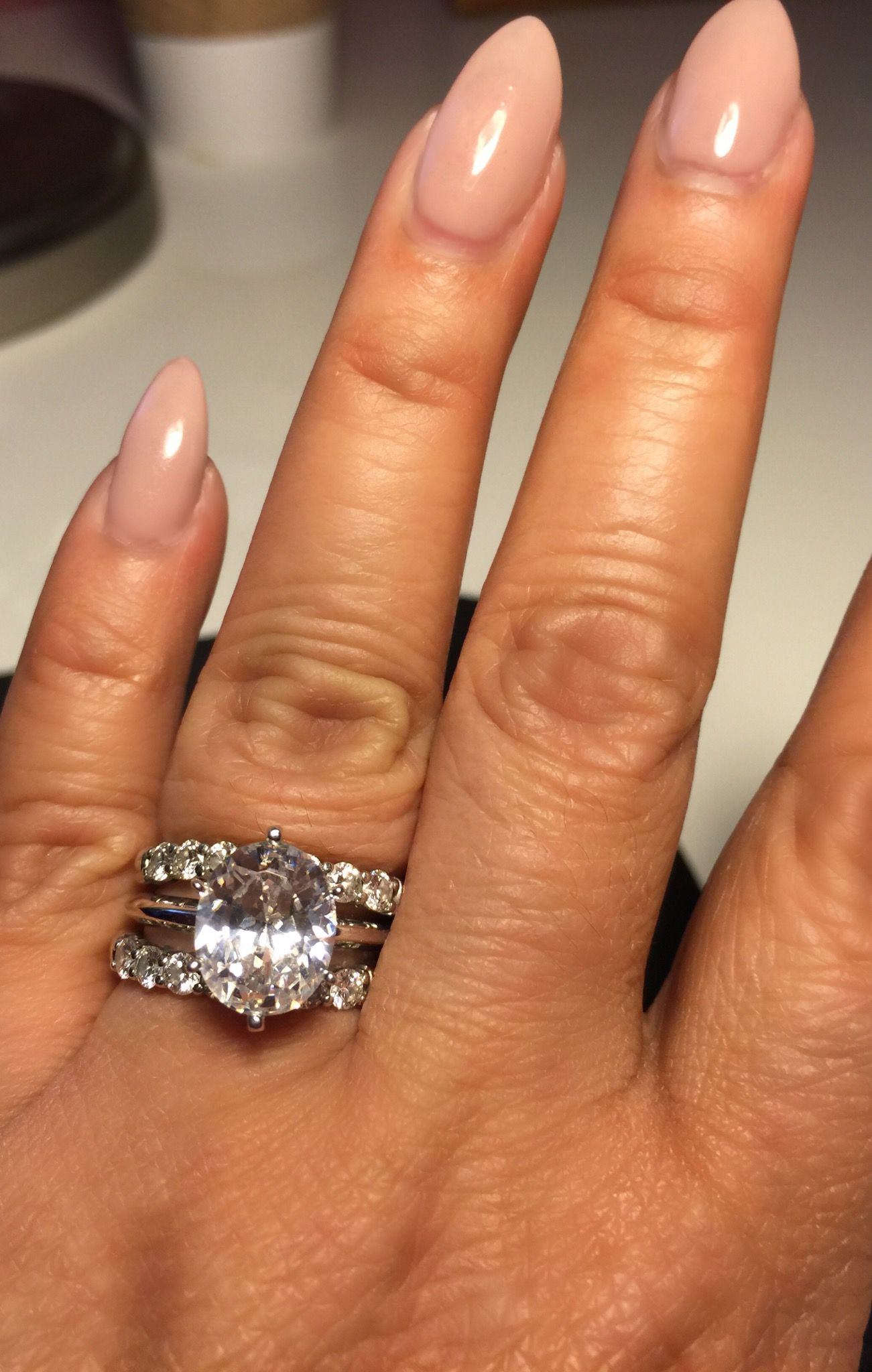 my customized 3 carat oval diamond ring placed in between. Black Bedroom Furniture Sets. Home Design Ideas