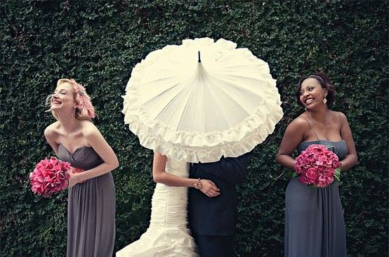 Ruffled white umbrella, wedding party