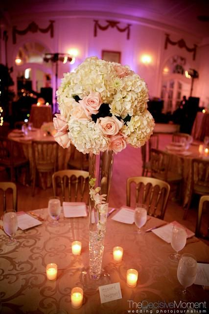 Lush ball of white hydrangeas and blush pink roses plated