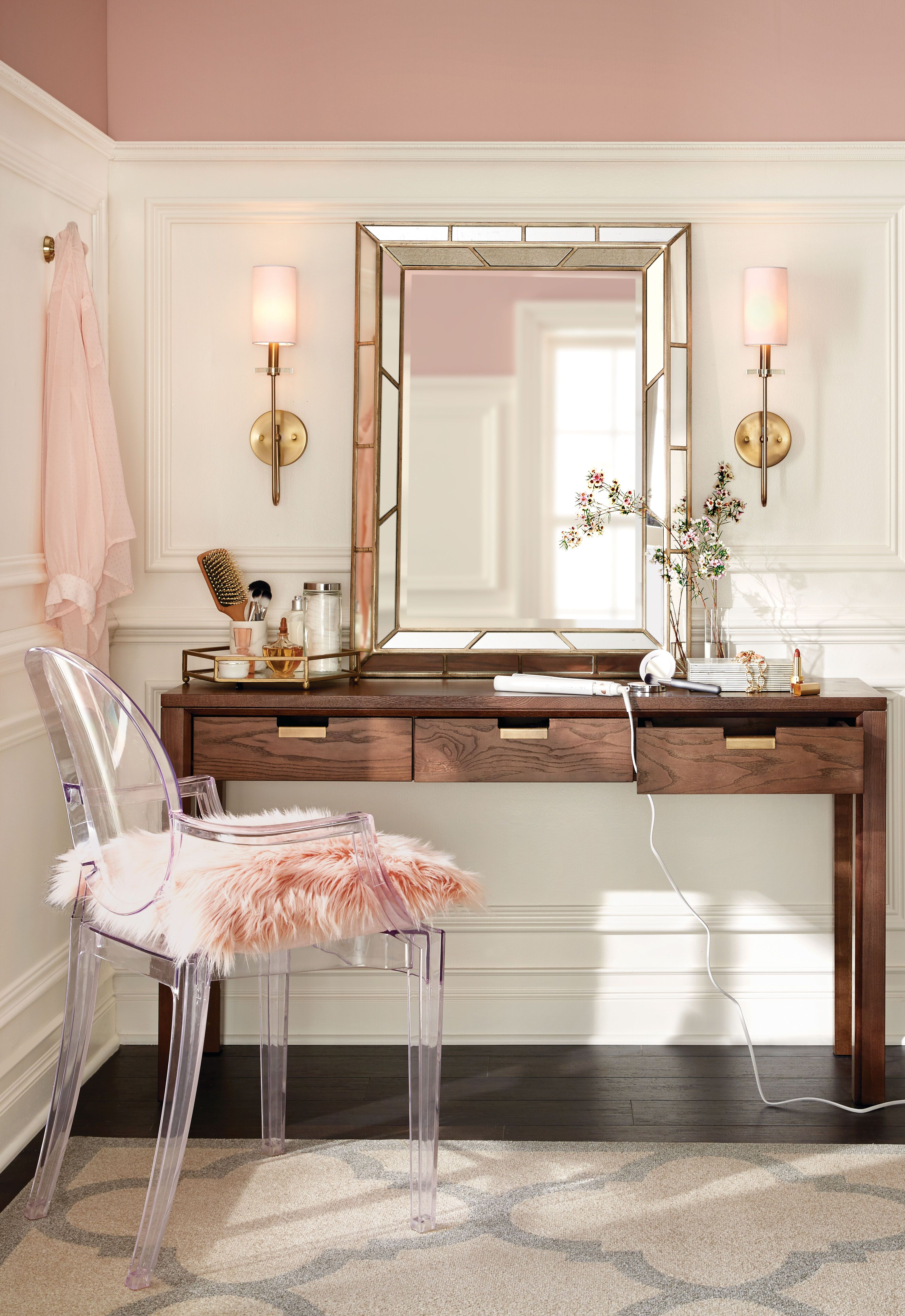 Create a sleek makeup vanity with a minimalistic desk and