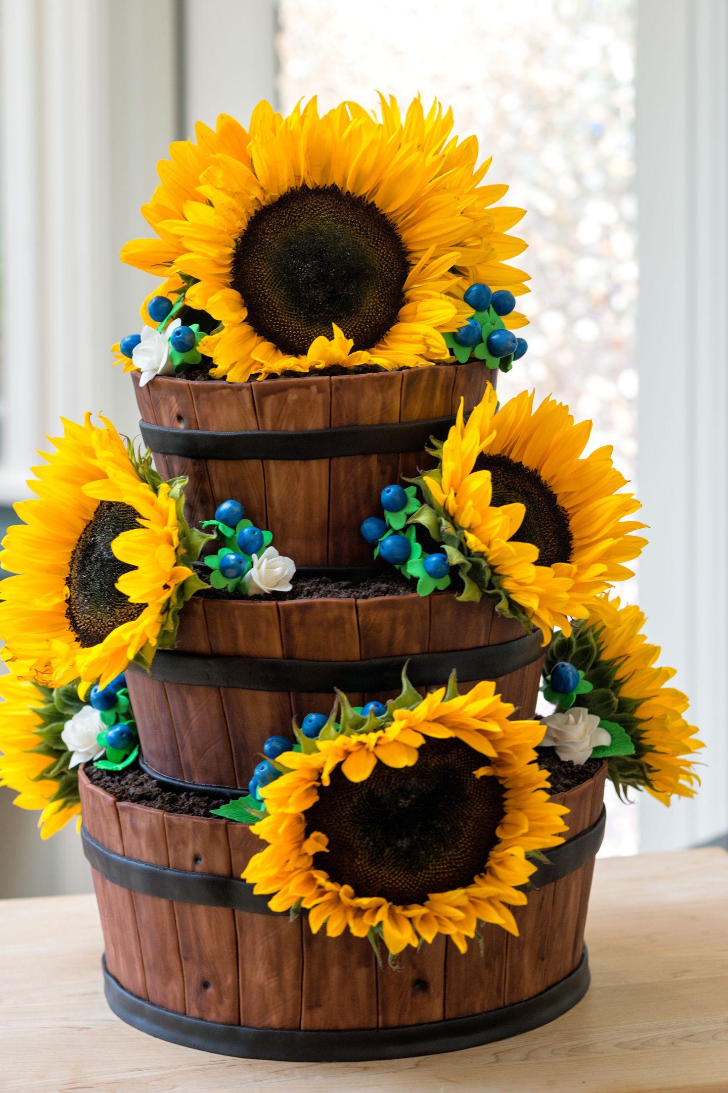 Sunflower blue berry white rose barrel wedding cake
