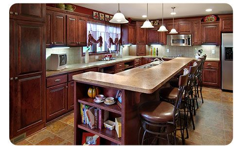 Kitchen remodel in MN features large island with storage and sink ...