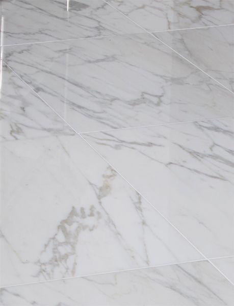18x18 Calacatta Gold Honed Marble Flooring Set On A Diagonal