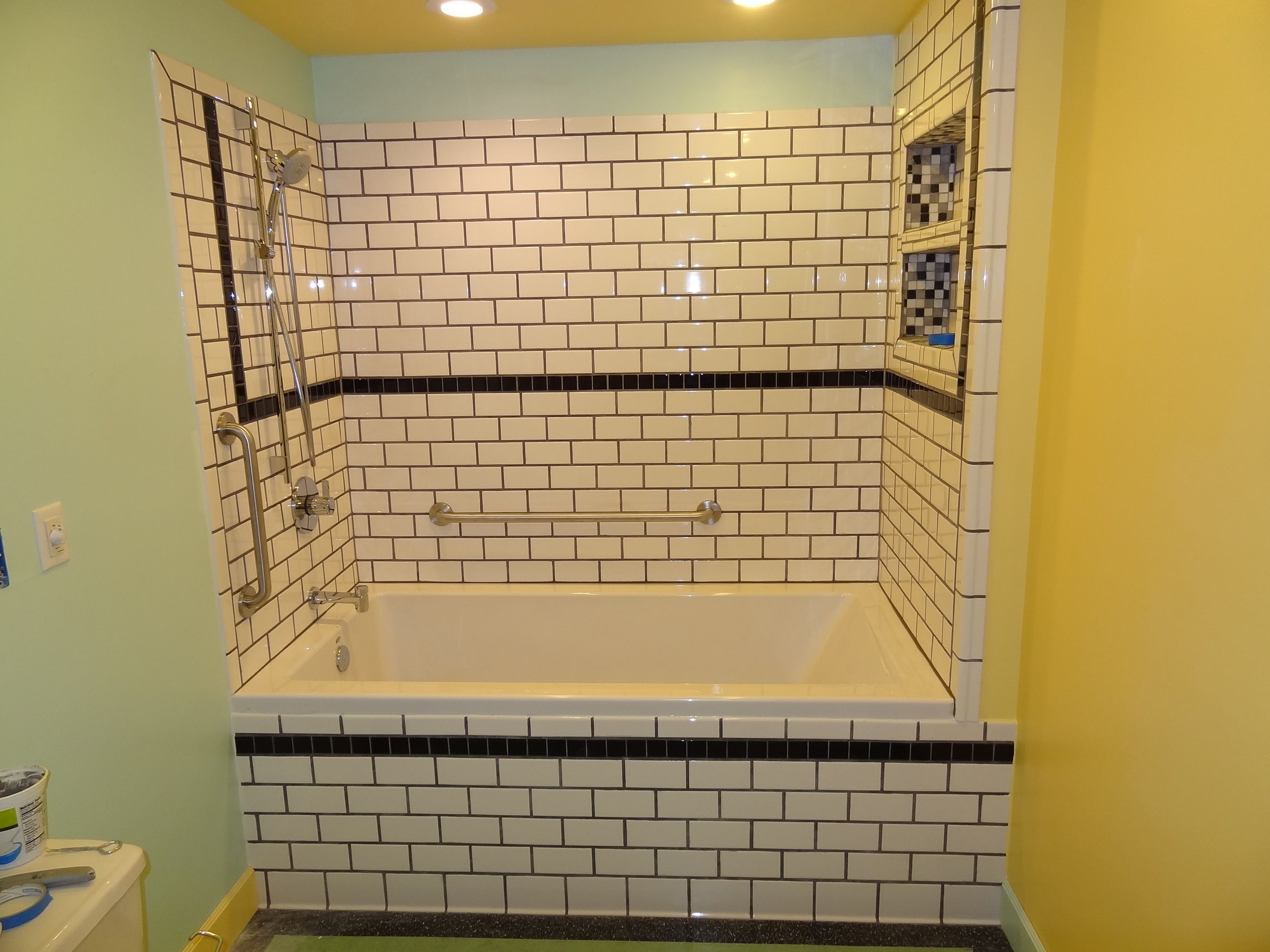 Deep soaking tub (6\'X3\'X2\') with subway tile surround in Ester ...